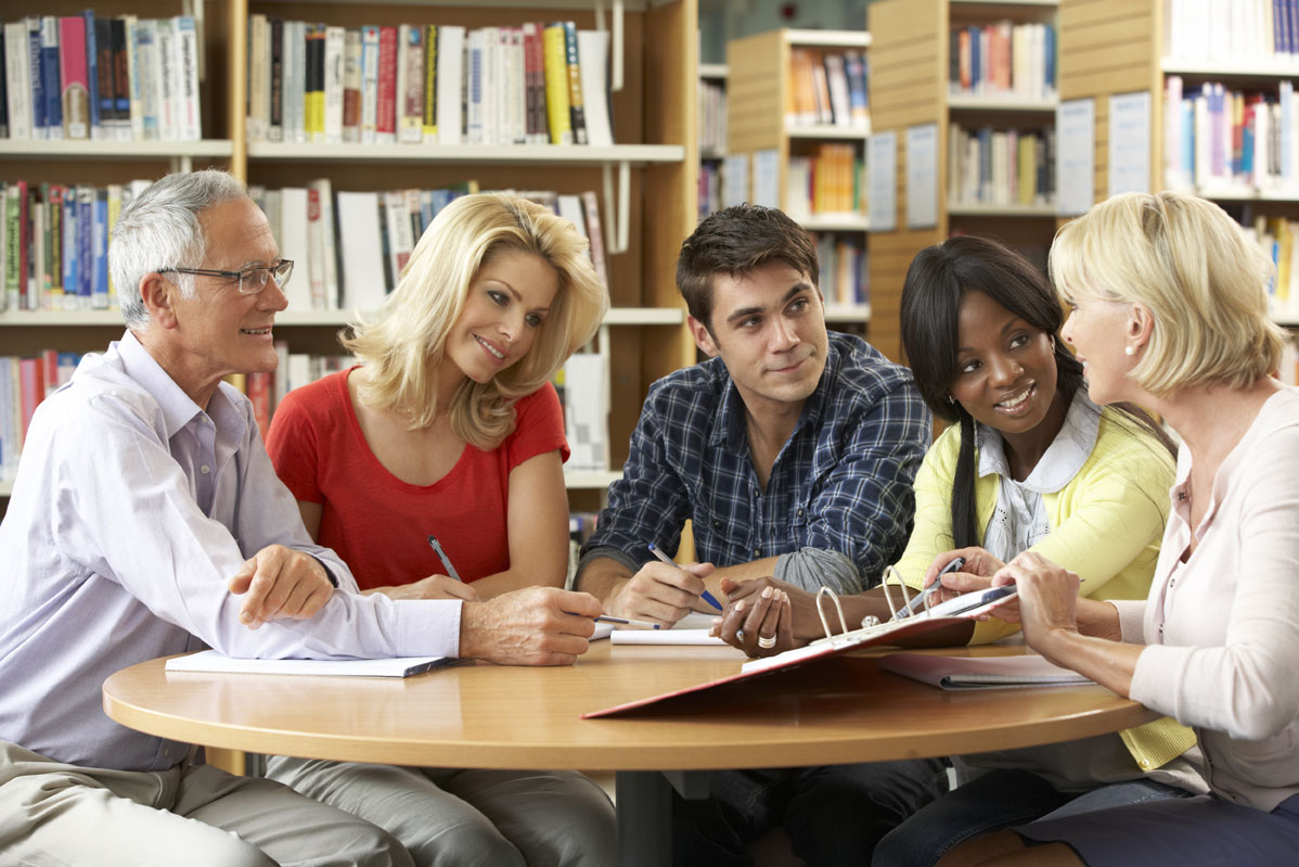 Adults in library smiling in conversation